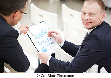 Business discussion - Close-up of two businessmen discussing...
