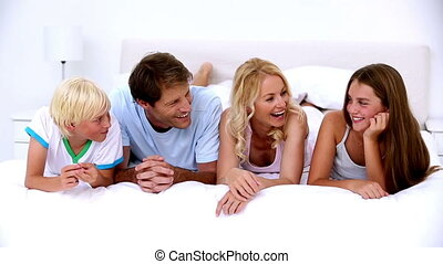 Cute family chatting together - Cute family chatting...