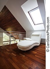 Mezzanine - Wooden attic with comfortable chair, stylish...