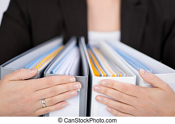 Businesswoman With Ring Binders - Midsection of...