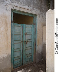 Blue double door - Double swing door to abandoned house