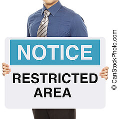 Restricted Area - A man holding a notice sign indicating...