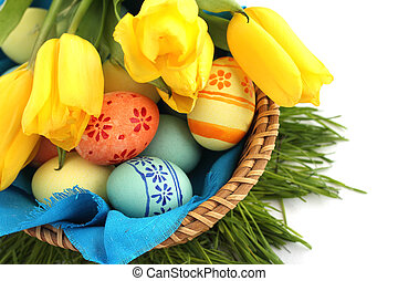 Basket of easter eggs and tulips on white - Basket of...