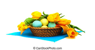 Easter eggs in basket with tulips - Colorful easter eggs in...