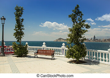 The skyline of Benidorm. Bench on balustrade and skyscrapers.