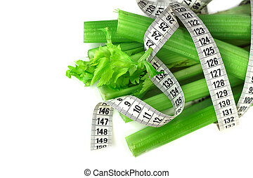 Celery and measure tape diet concept isolated on white...