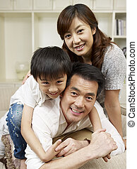 loving family - loving asian family having fun at home