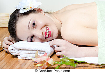 Young beautiful woman relaxing in spa salon