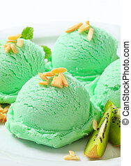 Scoops of light green ice cream and fresh kiwi