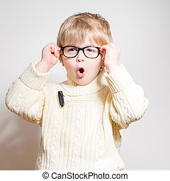 Wow: Little boy in eye glasses looking amazed - Little boy...