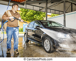 car wash - An image of a man washing his car