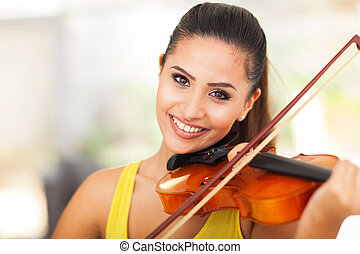 beautiful female musician playing violin - portrait of...