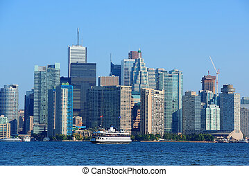Toronto skyline in the day over lake with urban...
