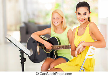 music tutor and student - portrait of beautiful music tutor...