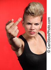 Fashion teenager girl showing middle finger isolated on a...