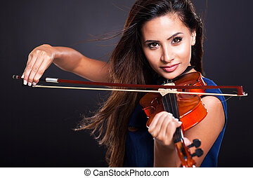 attractive woman playing violin - attractive young woman...