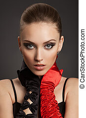 Fashion Portrait of a beautiful woman in gloves