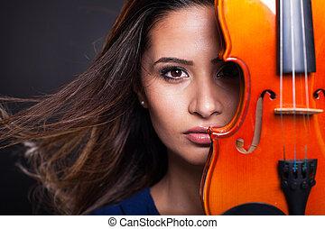 pretty woman behind a violin - portrait of pretty woman...