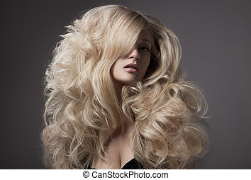 Beautiful Blond Woman. Curly Long Hair