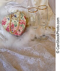 Silk and lace lingerie with floral heart, pearls and wine...