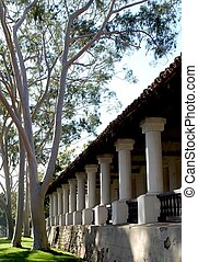 Spanish mission - Architectural columns and trees of spanish...