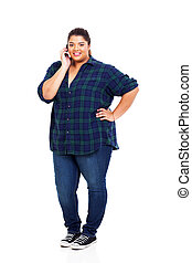 young obese teenage girl talking on cell phone - young...