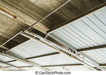 Garage ceiling - A industrial garage ceiling with open gates...