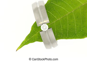 Wedding Ring - diamond wedding ring with green leaf isolated...