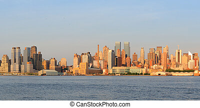 New York City Manhattan midtown skyline panorama at sunset