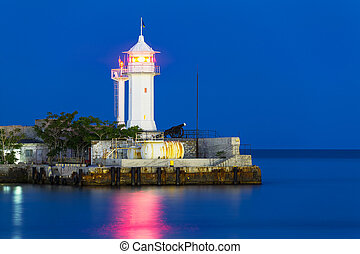 Lighthouse at night - Scenic night view of lighthouse with...