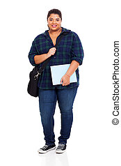 overweight university student holding text book - full...