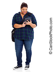 plus size college student with tablet computer - full length...