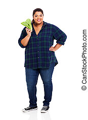 overweight young woman holding lettuce