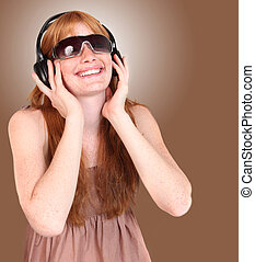 Redhead Listening to Music on Headphones
