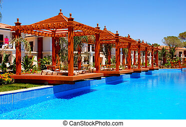 pool and pergola - summer landscape with swimming pool and...