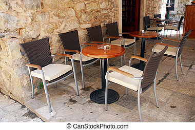 Mediterranean outdoor cafe - tables and chairs on outdoors...