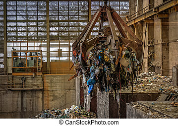 Waste processing plant interior with garbage