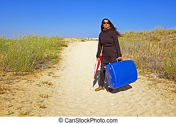 Woman traveling to her holiday destination - Woman...