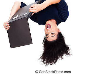 girl using laptop computer upside down - upside down photo...