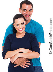 handsome man arms around his beautiful wife - portrait of a...