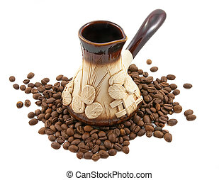Clay coffeepot with coffee beans on the white