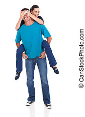 young womanl piggybacking on her boyfriend - attractive...
