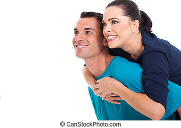 portrait of happy couple looking up over white background