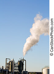 Industrial plant exhausting smokes into the atmosphere.