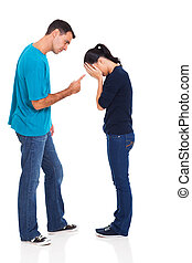 man pointing his crying girlfriend