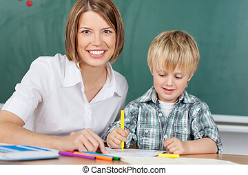Smiling educator with boy - Smiling educator with little boy...