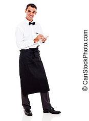 smiling waiter taking orders - smiling young waiter taking...