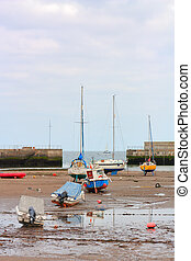 Several boats at low tide resting on their keel