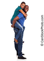 playful young african american couple piggyback
