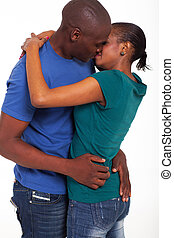 african american married couple kissing on white background